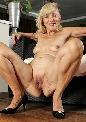 Alluring cougar doing what she does best 3